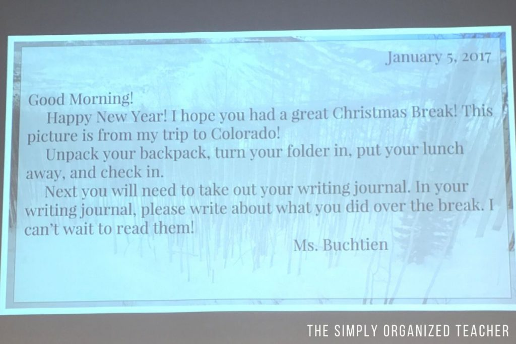 Photograph of a morning message displayed on the screen in a classroom.