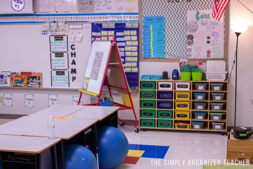 Elementary classroom math area. Bookshelf with bins storing math manipulatives.