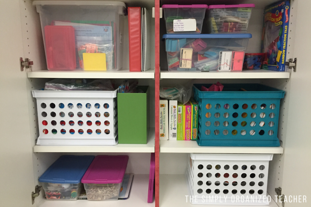 Boxes, bins, and plastic tubs inside of cabinets to help organize materials.