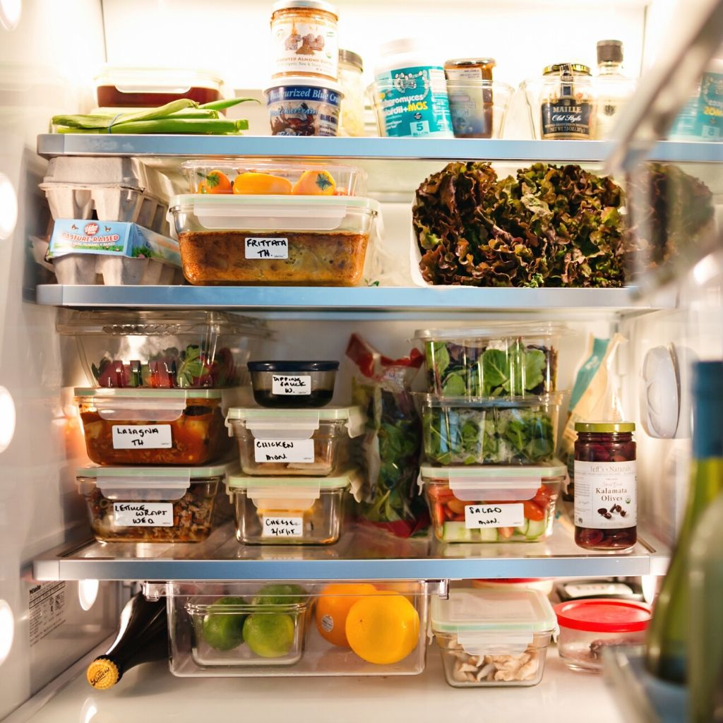 Containers for food prepared for the week inside of a refrigerator.