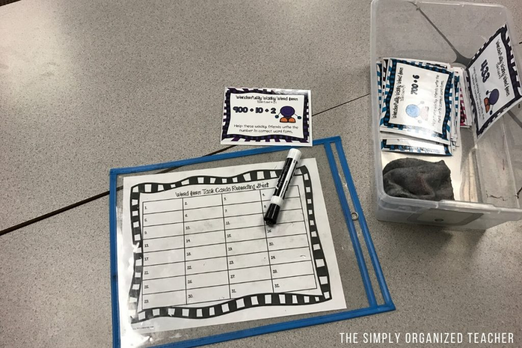 Math station activity inside of plastic protective sheet.