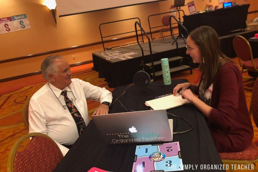 Kelly interviewing Dr. Kagan across a table.