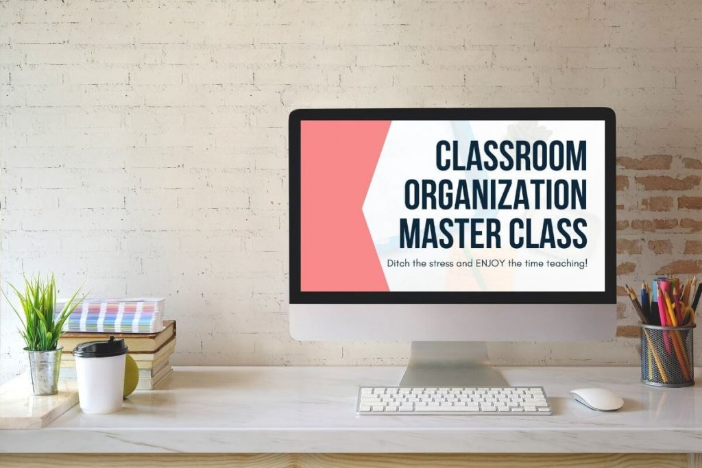 Computer on a desk with Classroom Organization Master Class slide on the screen