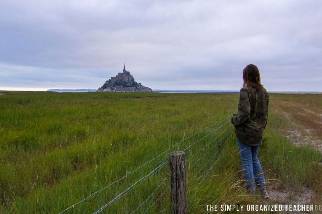 Woman staring off into distance looking at Mont St. Michel